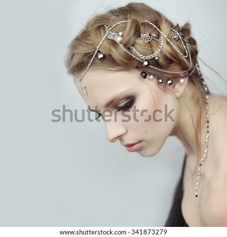 girl in medieval style. jewels in her hair. - stock photo