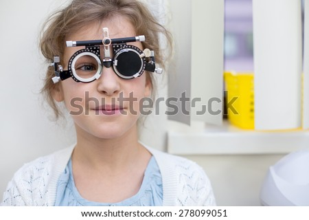 girl in ophthalmic glasses - stock photo