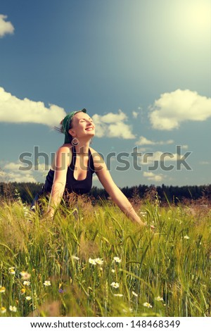 Girl in Pin up in a field enjoying life