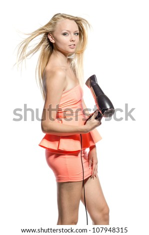 girl in pink dress with hairdryer - stock photo