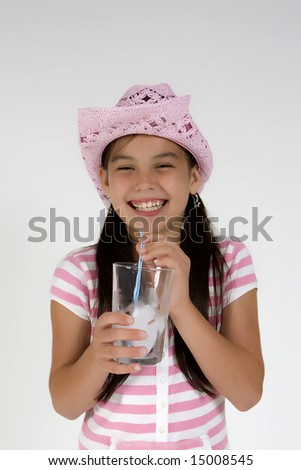 Girl in pink drinking from a glass - stock photo