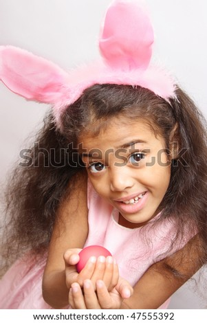 girl in rabbit costume with easter egg