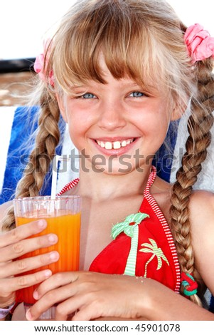 Girl in red bikini drink orange juice. - stock photo