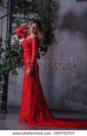 Girl in red dress enthralling