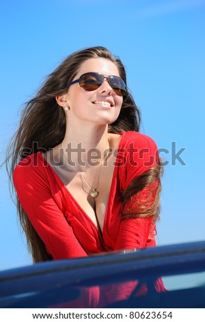 girl in red dress in cabriolet