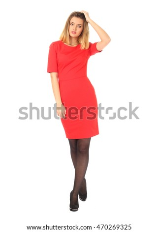 Girl in red dress isolated on white