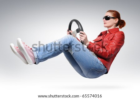 Girl in red leather and sun glasses with a wheel - stock photo