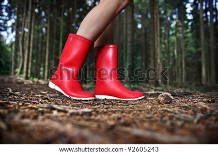 Girl in Red Rain Boots in the Forest