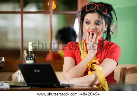 Girl in red t-shirt with notebook