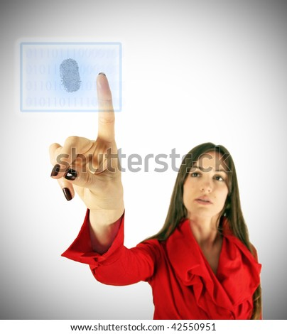 Girl in red touch virtual display with finger. Modern technology concept.