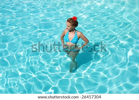 Girl in resort swimming pool