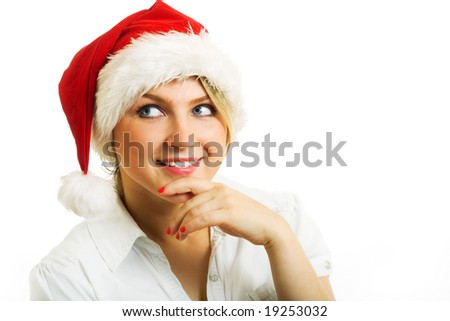 Girl in Santa hat dreaming about....