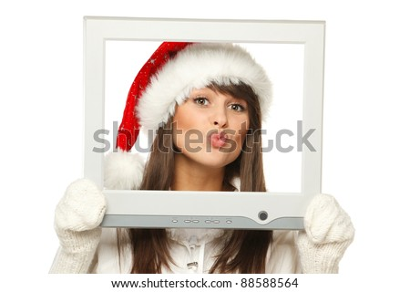 Girl in Santa hat sending you a virtual kiss from TV / computer screen frame, isolated on white background. - stock photo