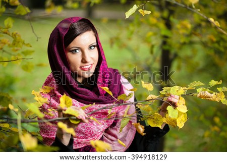 Girl in scarf at autumn park. - stock photo