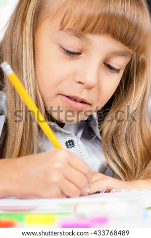 Girl in school at the desk - stock photo