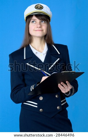 Girl in sea uniform with tablet and pen