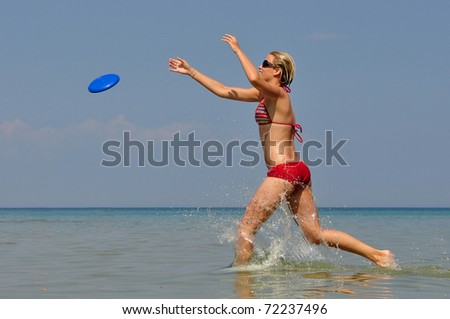 girl in sea with flying saucer