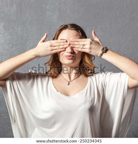Girl in see no evil pose - stock photo