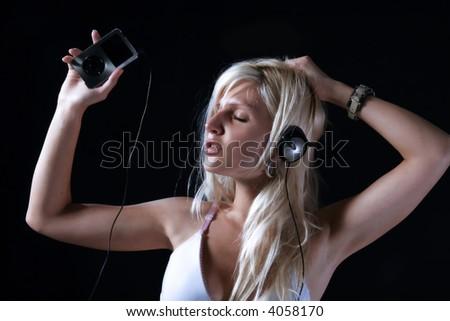 girl in sensual movement listening music - stock photo