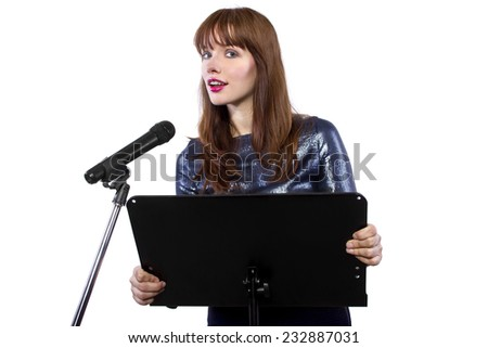 girl in shiny dress speaking on a microphone in a podium on white background - stock photo