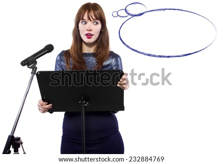 girl in shiny dress speaking on a microphone in a podium on white background with text space - stock photo