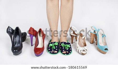 Girl in Slippers before choosing shoes - stock photo