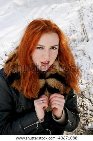 Girl in snow wood - stock photo