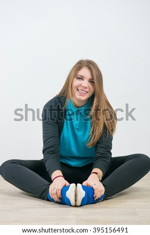 girl in sportswear. cheerful young woman doing fitness exercises at home - stock photo