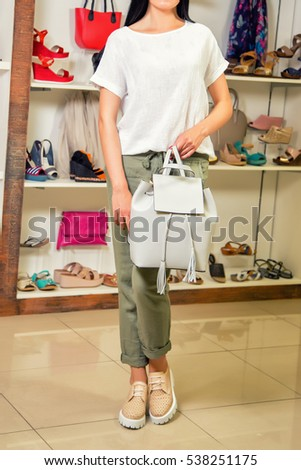 girl in stylish clothes clothing store