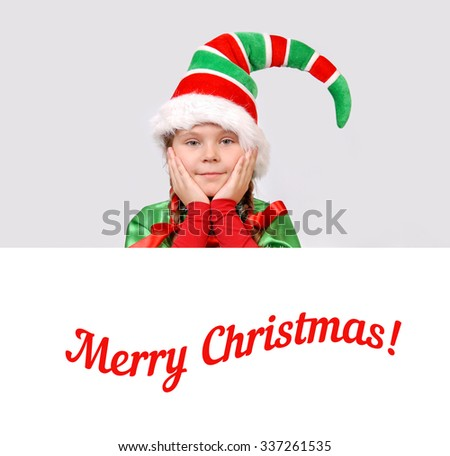 Girl in suit of Christmas elf with the white banner - stock photo