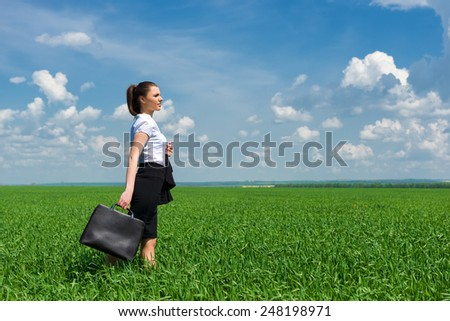 girl in suit walking on a field