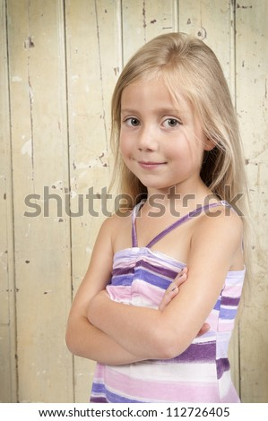 girl in summer dress, arms crossed - stock photo