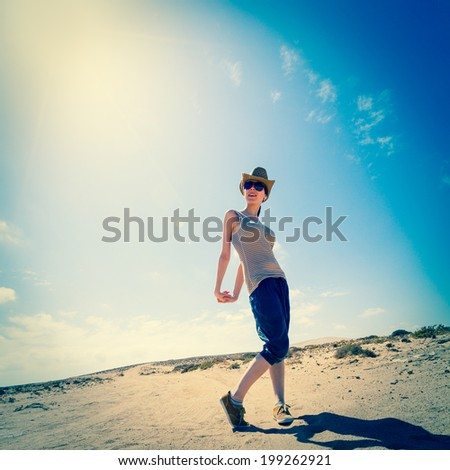 girl in sunglasses and cowboy hat posing - stock photo