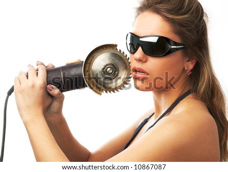 girl in sunglasses is holding circular saw near her cheek isolated on white