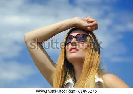 Girl in sunglasses looking at the sky