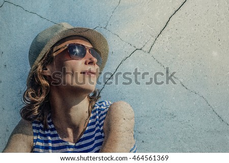 Girl in sunglasses on a blue background.