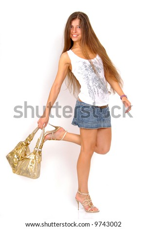 girl in sunglasses with golden bag on the light background