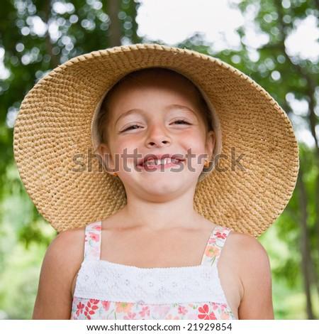 Girl in sunhat - stock photo