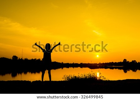 Girl in sunset ,Gold light from sunset ,Freedom and happiness girl in nature