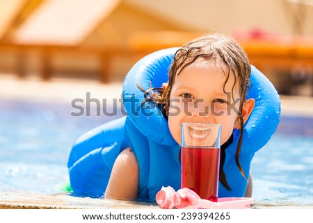 Girl in Swimming Pool Outdoors shot - stock photo