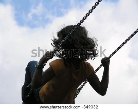 girl in swing - stock photo