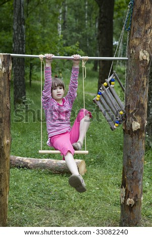girl in swing. Child camping