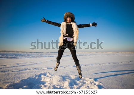 girl in the air above the snow