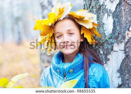 Girl in the autumn forest