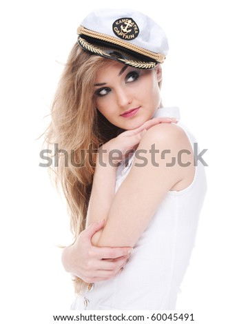 Girl in the captain's cap poses on a white background - stock photo