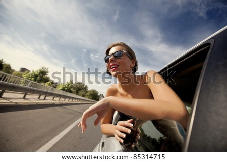 Girl in the car - stock photo