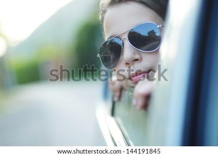 girl in the car looking throw window - stock photo