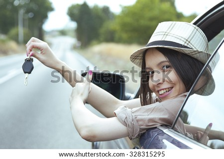 girl in the car with the key - stock photo