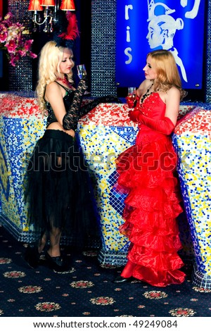 Girl in the clothes of past years in style Cabaret Moulin Rouge - stock photo