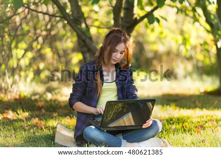 Girl in the garden with the laptop